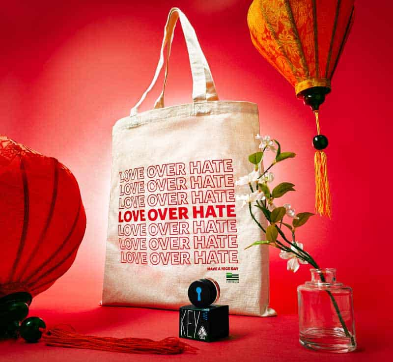 Love Over Hate Tote Bag with Red Background